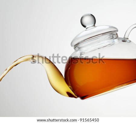Transparent Glass Teapot with Tea - stock photo