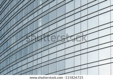 transparent glass windows of office building with reflections - stock photo