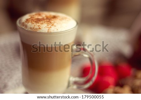 Transparent glass with latte in a cafe - stock photo