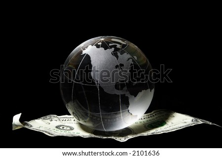 Transparent globe on a US dollar floating in black - stock photo