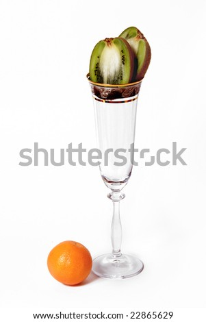 transparent goblet with  kiwi and mandarin  isolated on white