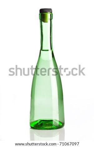 Transparent green bottle isolated on white background - stock photo