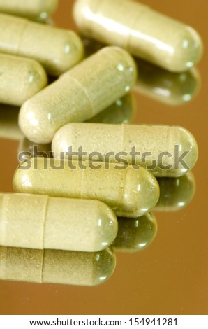 Transparent Hard Gelatin Capsules filled with Herbal medicines. - stock photo