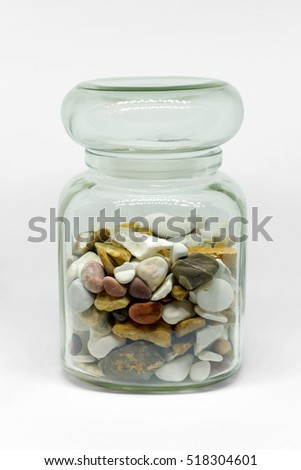 Transparent jar with colored stones