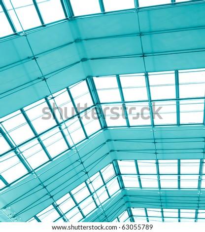 transparent light ceiling inside shopping mall - stock photo