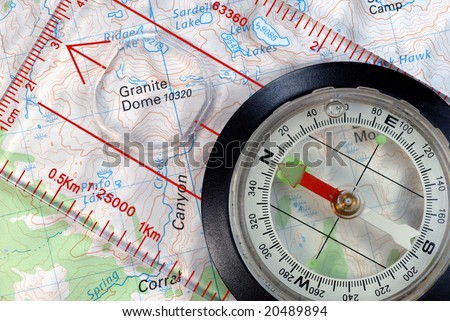 Transparent Navigational Compass on Topographical Map, Needle Pointing to Magnetic North