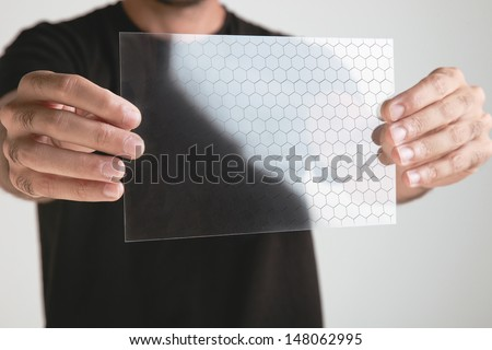 Transparent of graphene application with binary numbers concept.  Graphene application - stock photo