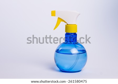 Transparent plastic sprayer bottle with water over white - stock photo