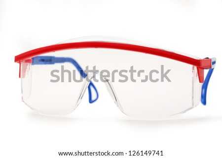 Transparent protective goggles on white - stock photo