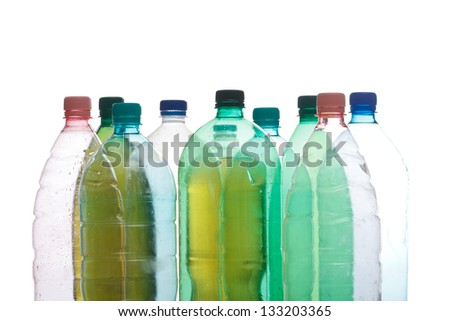 Transparent recyclable plastic bottles in different color - stock photo