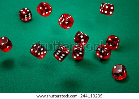 transparent red dice over green felt