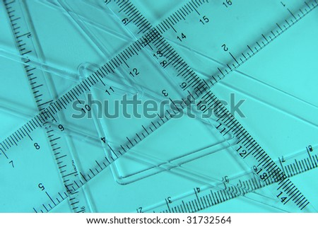 Transparent rulers against a blue background (as an abstract mathematical background) - stock photo