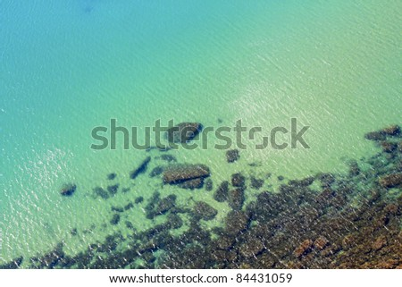 Transparent sea with stones under water - stock photo
