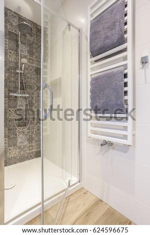 transparent shower stall in a modern bathroom