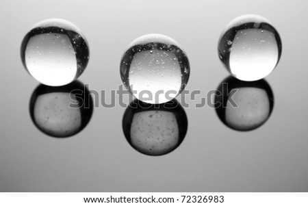 Transparent spheres on glossy background - stock photo
