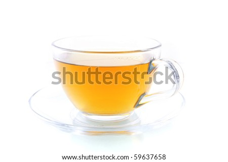 transparent tea cup with lemon over white background