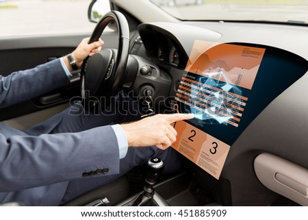 transport, business, modern technology and people concept - close up of man driving car and pointing finger to chart and low poly shape on board computer screen