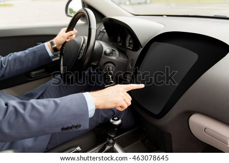 transport, business, modern technology and people concept - close up of man driving car and pointing finger to blank on-board computer screen