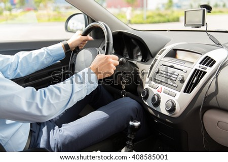 transport, business trip, destination and people concept - close up of young man driving car - stock photo