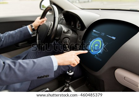 transport, business trip, green energy, technology and people concept - close up of man driving car and using eco system mode on board computer
