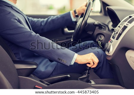 transport, business trip, speed, destination and people concept - close up of young man in suit driving car - stock photo