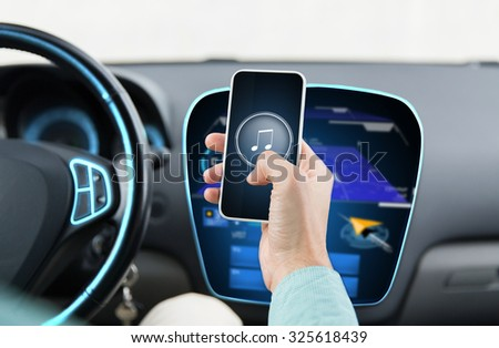 transport, business trip, technology and people concept - close up of male hands with musical note icon on smartphone screen in car - stock photo