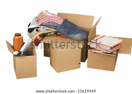 transport cardboard boxes with books and clothes on white background