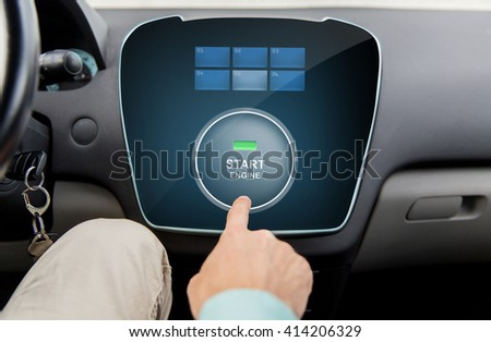 transport, driving, technology and people concept - close up of male hand using starter application on car computer - stock photo