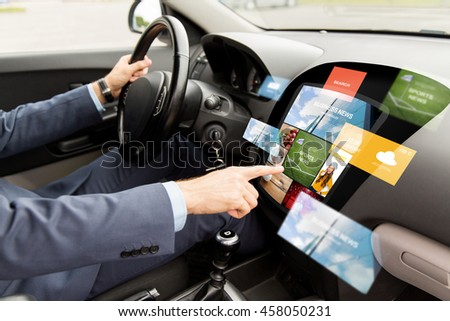 transport, modern technology, business, media and people concept - close up of man driving car with news on board computer screen