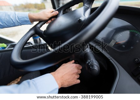 transport, transportation, tourism, road trip and people concept - close up of bus driver starting bus - stock photo