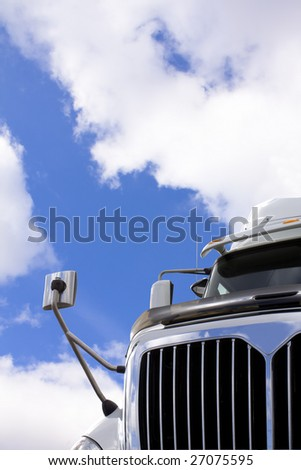 Transport truck against sky with clouds - stock photo