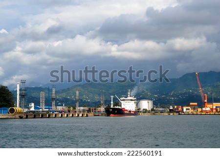 Transportation and infrastructure in commercial sea port - freight ships, logistic terminal and sea cranes in harbor. - stock photo