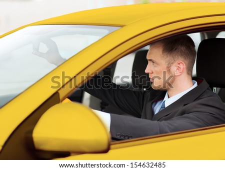 transportation and vehicle concept - businessman or taxi driver driving a car - stock photo