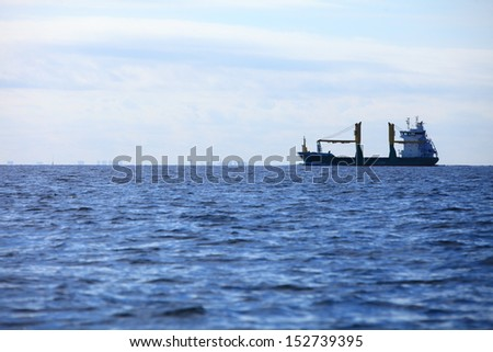 Transportation, cargo conteiner ship sailing in still water heading for the port