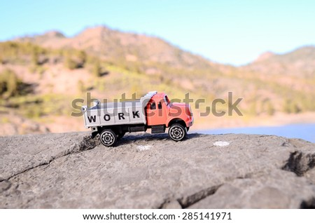 Transportation Concept Old Toy Truck on the Rocks - stock photo