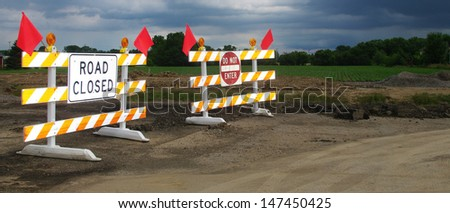 Transportation concept: red and white warning flags colors fenced protected area - stock photo