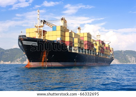 transportation, containers cargo ship out of the harbor - stock photo