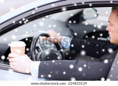 transportation, drinks, people and vehicle concept - close up of man drinking coffee while driving car - stock photo