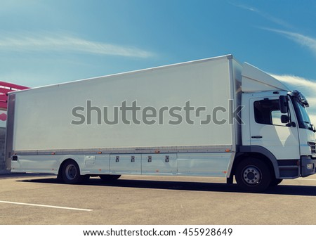 transportation, freight transport, advertisement and vehicle parts concept - truck on city parking - stock photo