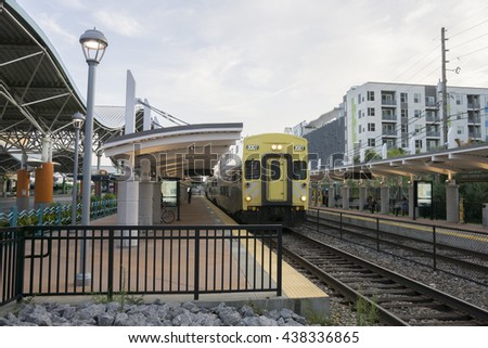 Transportation hub facility/Orlando Transit Center/Buses and trains leaving for morning commute , - stock photo