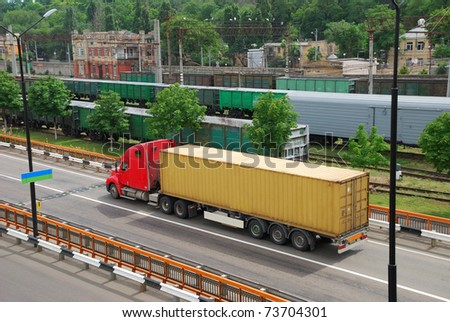 Transportation of cargoes by lorry and railroad - stock photo