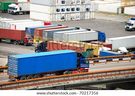 Transportation of cargoes in containers by lorry - stock photo