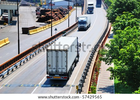 Transportation of containers by lorry - stock photo