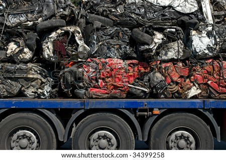 Transportation of crushed cars for recycling - stock photo