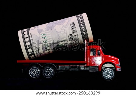 Transportation of Money for the Red Toy Truck Business Concept - stock photo
