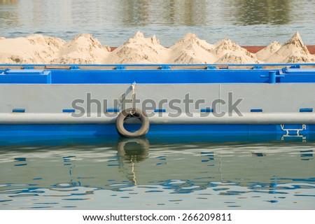 Transportation of sand - stock photo