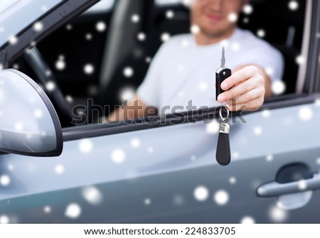 transportation, people, season and ownership concept - close up of smiling man with car key outdoors - stock photo