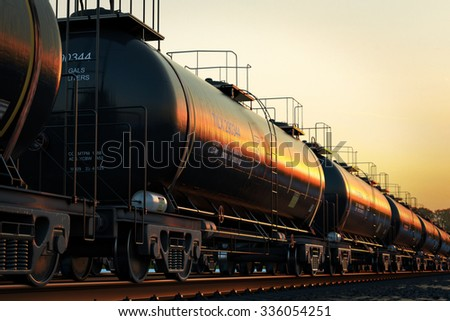 Transportation tank cars with oil during sunset. - stock photo
