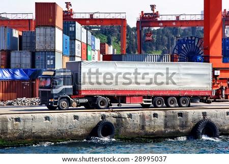 Transportation truck in port - stock photo