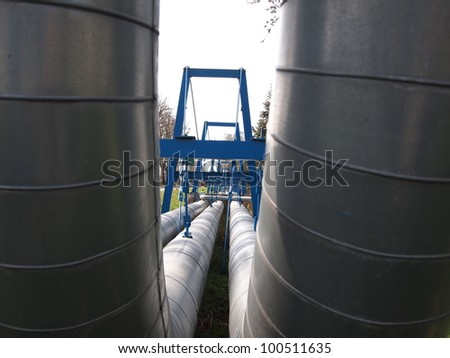 transporting hot water metal pipes - stock photo